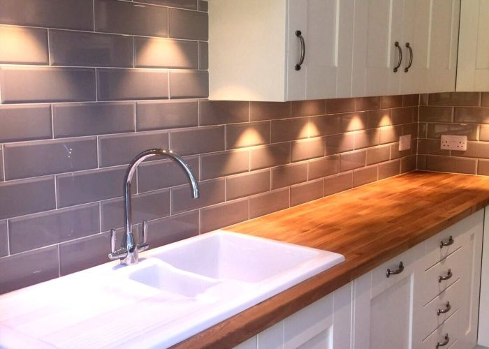 Our edge grigio tiles look lovely in  cream kitchen with wooden worktops cabinets above sink lights also iluminaci  mesada cocinas pinterest kitchens house and interiors
