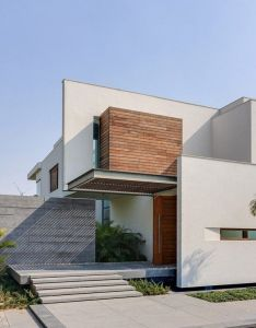 Entrance walkway overhang opulence meets contemporary architecture in new delhi india house also architect modern home dreamhome dreamhouse rh pinterest