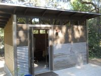 modern shed. corrugated metal siding on lower 1/3rd of ...