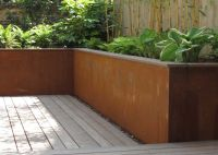 Small city garden with raised corten steel planters ...