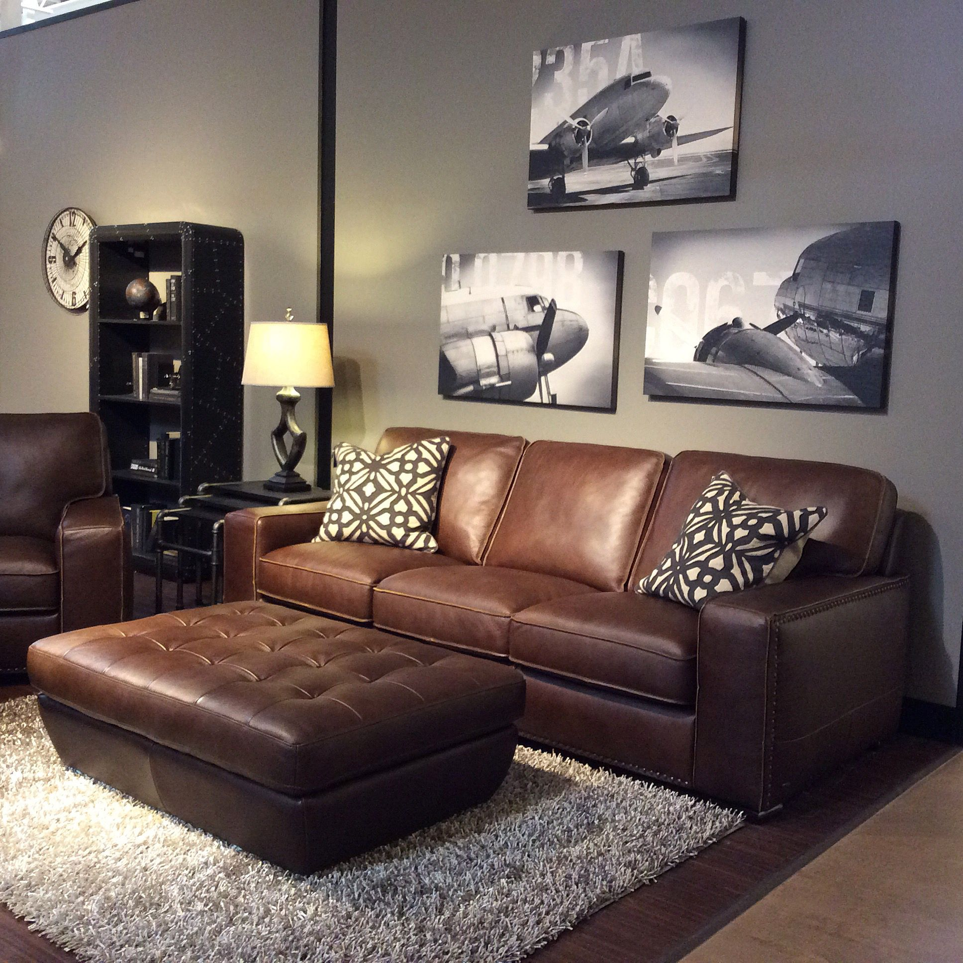 brown leather sofa grey walls surefit slipcovers for sleeper family room with warm gray black and white art