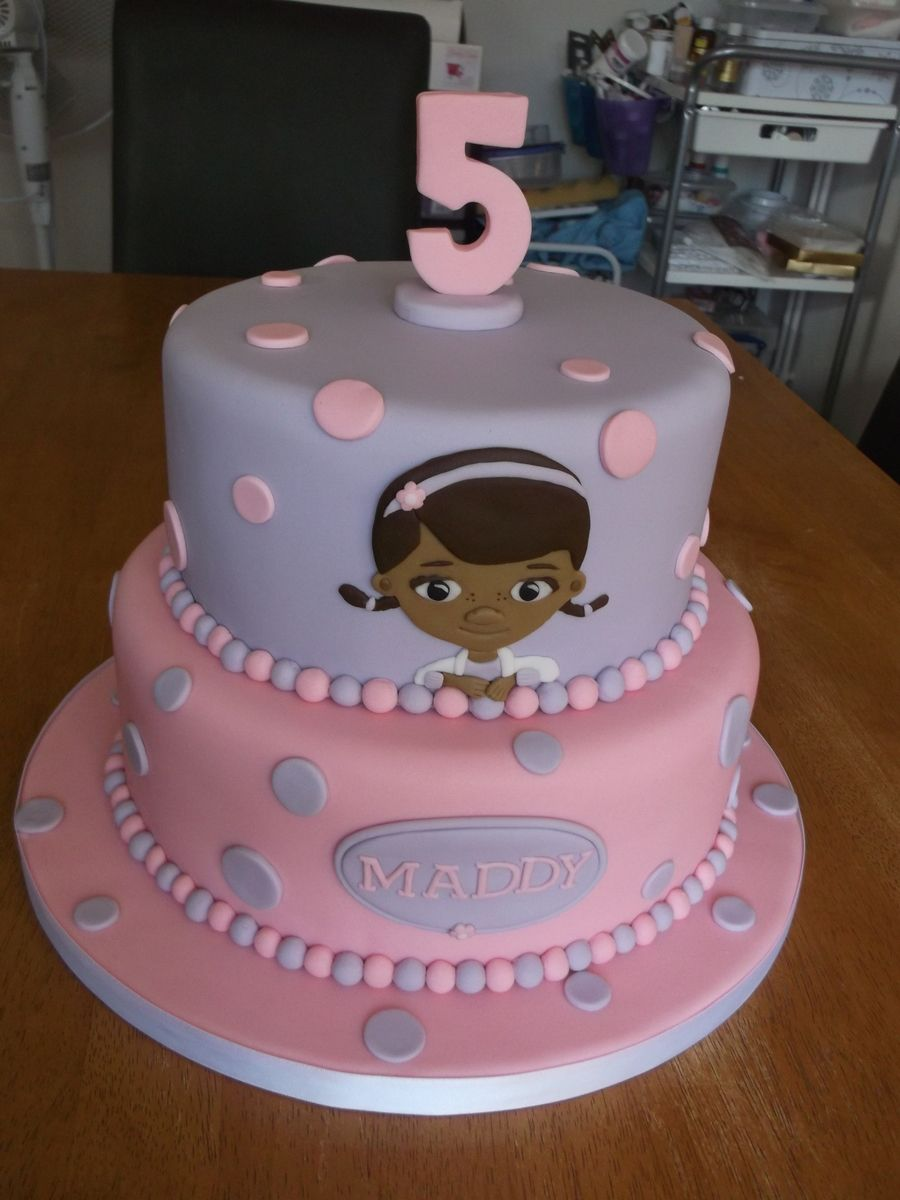 A 7 And 9 Inch Two Tier Cake With Doc Mcstuffins On The
