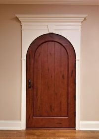 Arched interior door withing rectangular frame. Image ...