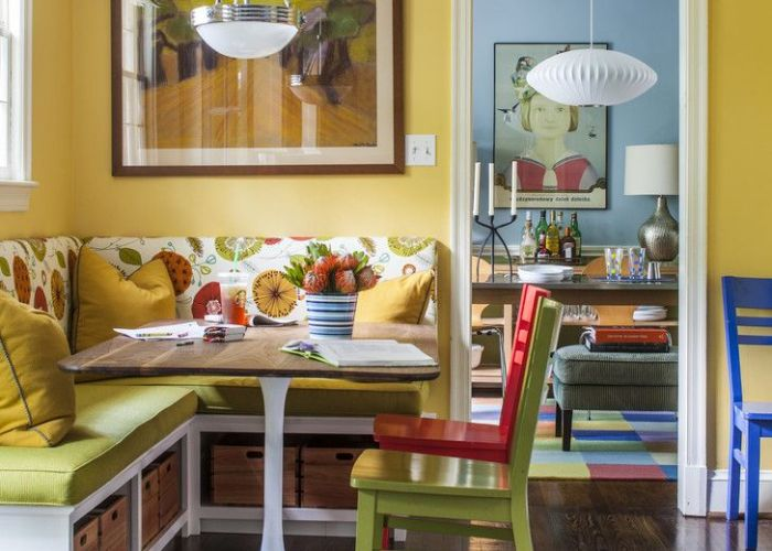 Dining booth for home patterned bench table chairs pendants hardwood floor framed painting yellow walls eclectic also