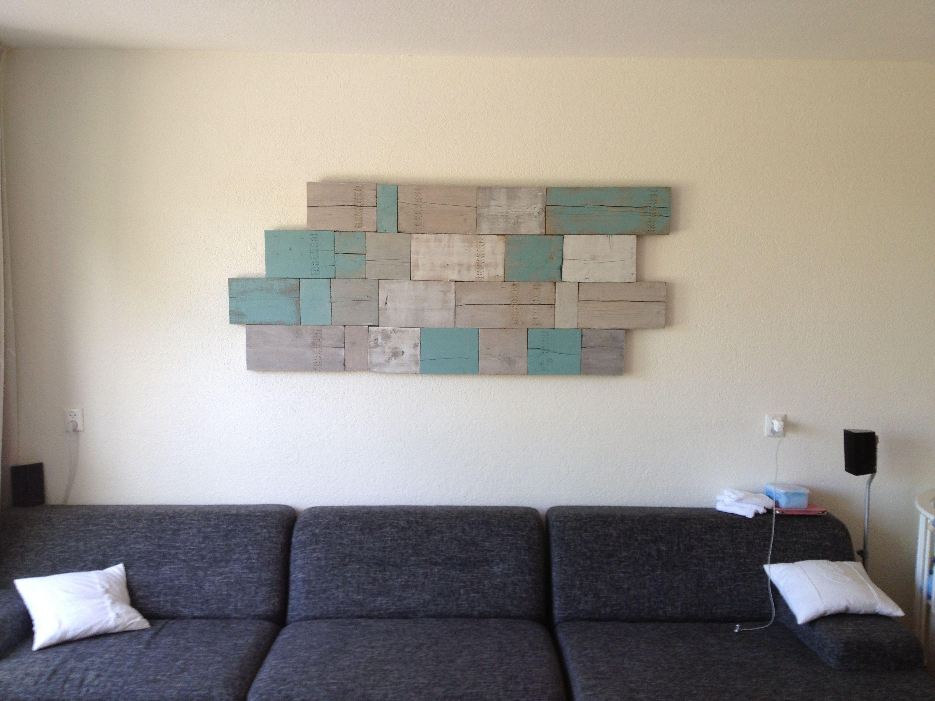 Muurdecoratie gemaakt van resthout steigerhout verf en