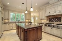 light cabinets with dark island, and dark granite counter ...