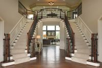 A double staircase makes a bold design statement in the ...