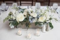 Serenity Blue floral table centerpiece for a baby boy