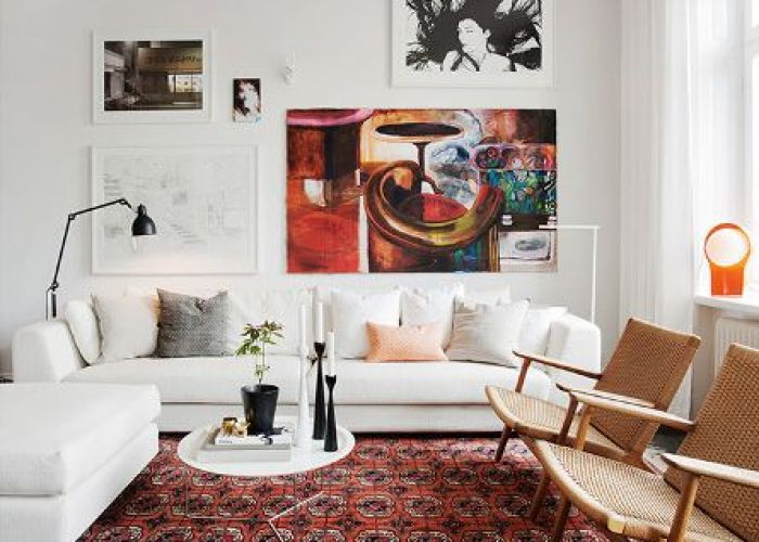 Warm cozy living room with oriental rug white sofa danish modern chairs gallery art wall also classic home apartment walls  couch