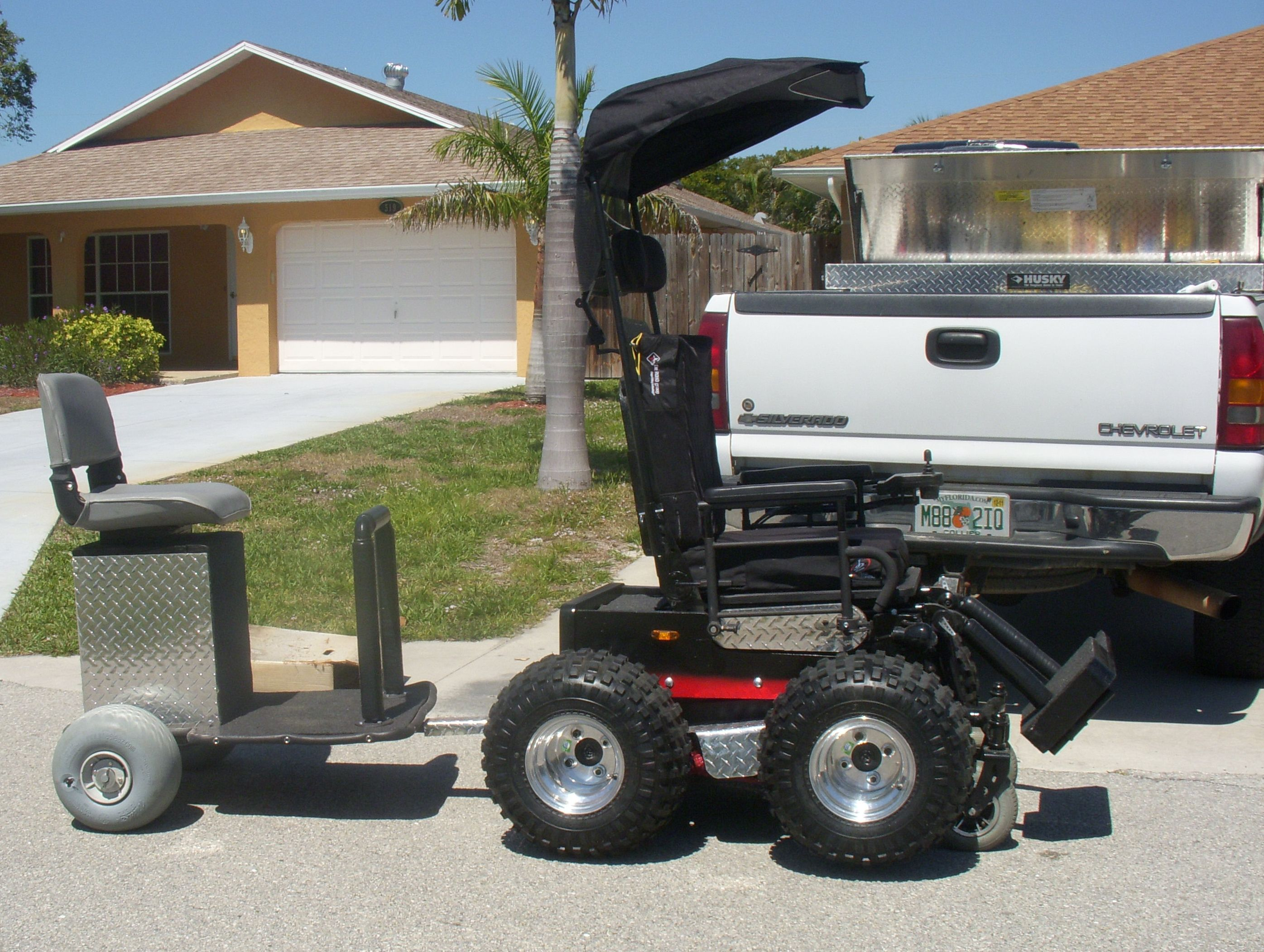 wheelchair trailer bedroom chair size extreme wheelchairs and scooters