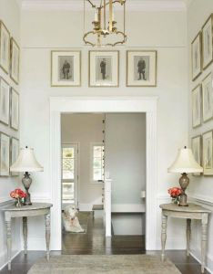 Benjamin moore classic gray source traditional home allison hennessy chic elegant foyer with antique brass lantern twin demilune console tables also belclaire house white walls beautiful lighting pinterest rh za