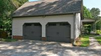 Carriage style garage door dark gray. Amarr's Oak Summit