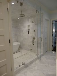 Steam shower with marble tiling. Swing in and out doors ...