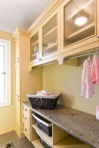 Laundry Room - I love the subtle under-cabinet hanging ...