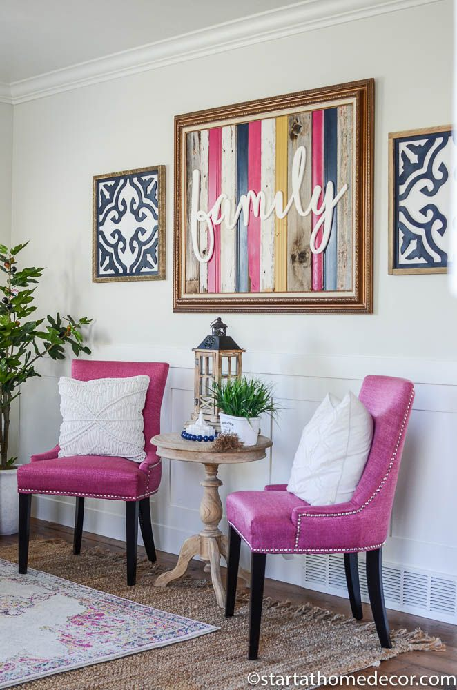 Pink chairs navy and yellow decor in my living room  love the reclaimed wood sign with black white tile inspired signs on each side also color decoracion  rh pinterest