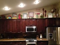 how to decorate on top of cabinets with vaulted ceiling ...