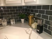 Glass Subway Tile Gray 3x6 1/8 Spacers used. Calacatta