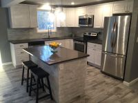 #Modern #Kitchen #Gleaming white cabinetry, quartz counter ...