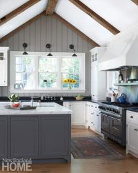 Wood beams and painted beadboard emphasize the vaulting of ...
