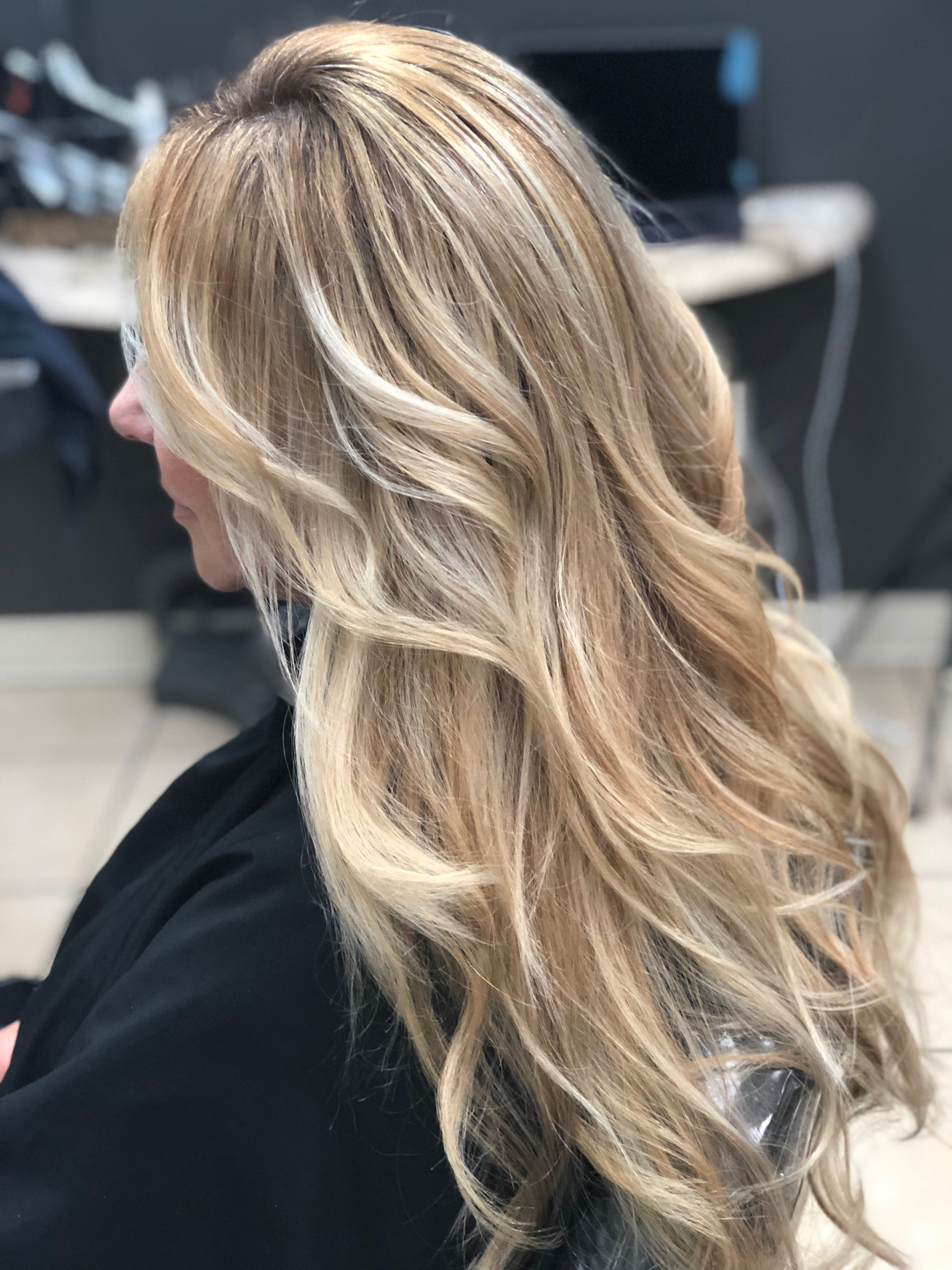 Highlighting hair with low lights and blonde balayage by hair