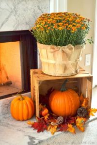 Fall mums and pumpkins give this fireplace a lovely, warm ...