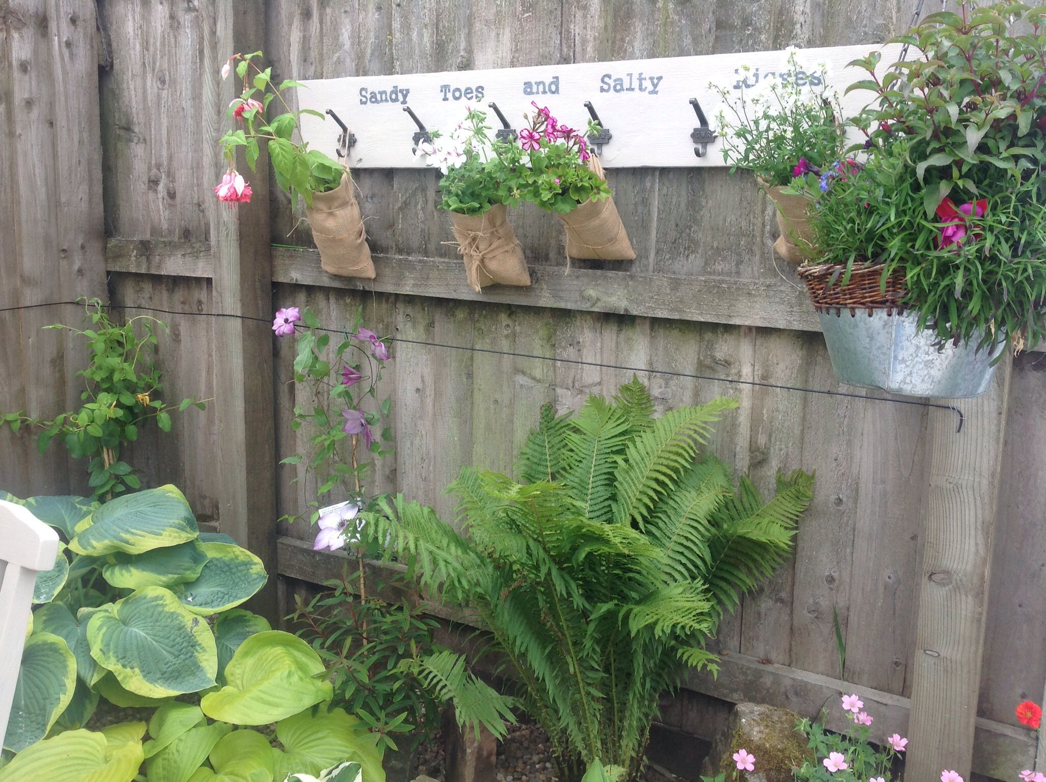 Hanging Burlap Plant Pockets On An Old Painted Plank