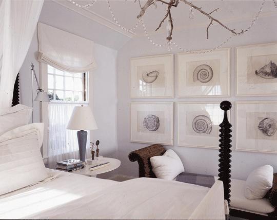 beachy coastal bedroom design with soft gray blue paint