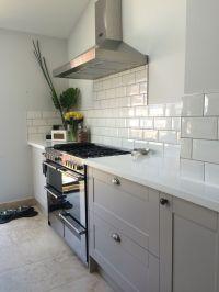 Grey burford kitchen with White corian worktops and subway ...