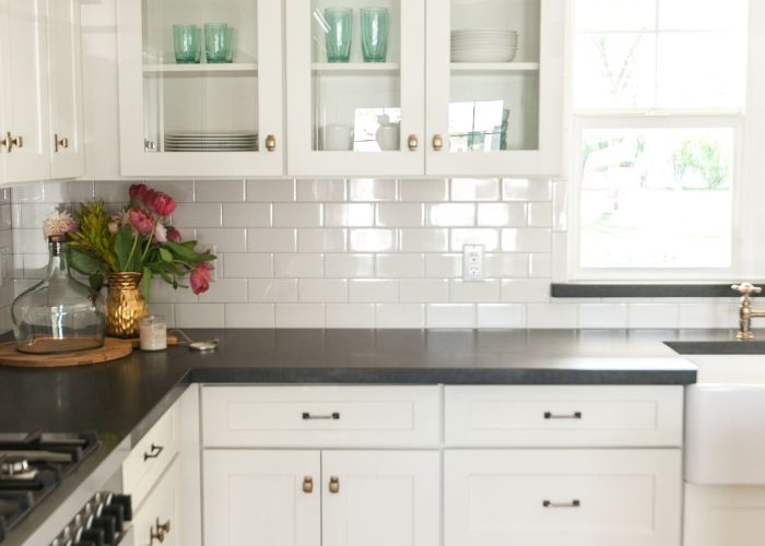 White shaker cabinetry with glass upper cabinets as featured on  rafterhouse  pilot episode hgtv black granite and subway tile similar to our also