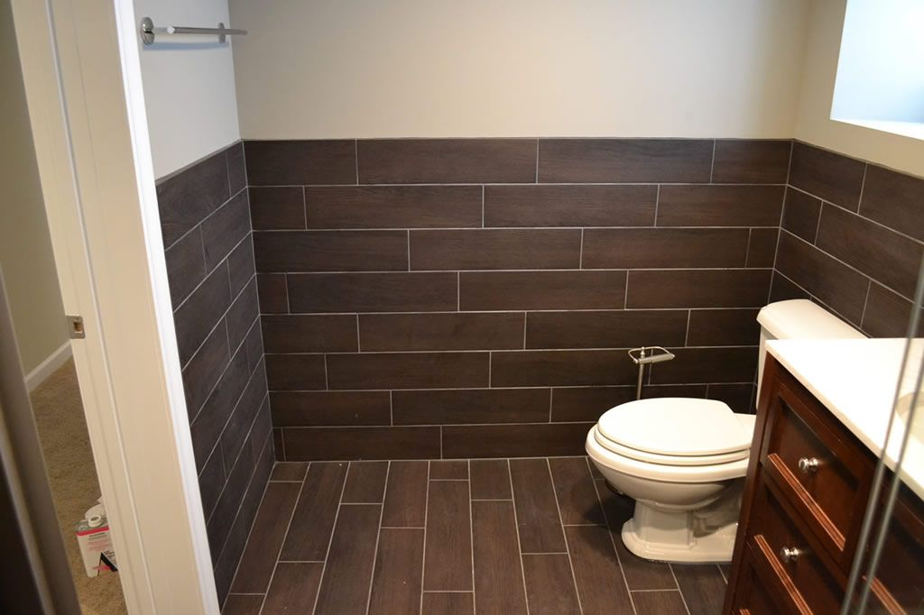 Floor tile extends to wall