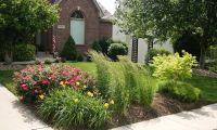 Corner landscape installationpanting- daylily, rose ...
