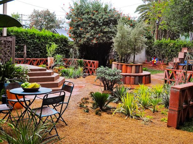 Rustic Backyard Patio This Garden Features A Detailed Fence And A