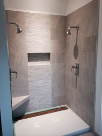 Contemporary shower. 12x24 tile with 12x24 muretto accent ...