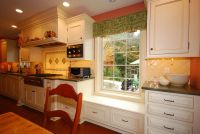 low kitchen window seat with cabinets built out on both ...