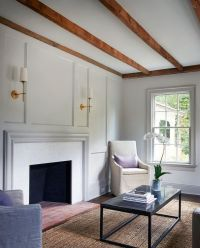 Chic living room boasts a rustic wood ceiling beams over a ...