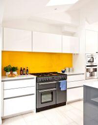 White modern kitchen with yellow splashback | Yellow ...