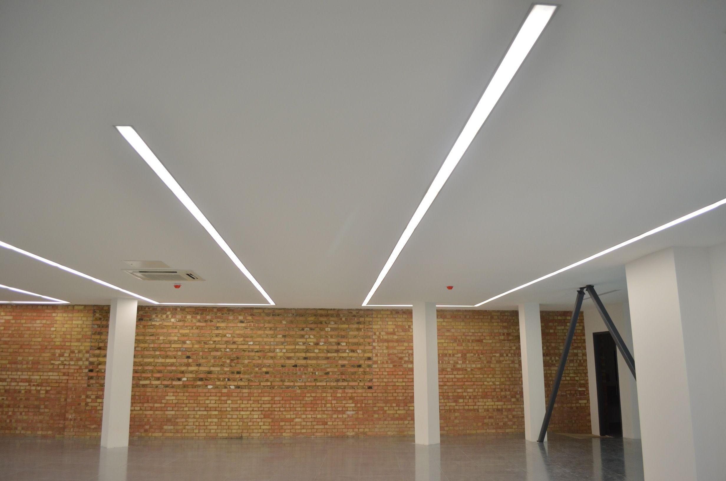 Continuous LED strip light Kings Cross office development by gpad london LEDlighting striplight office  Lighting Design  Pinterest