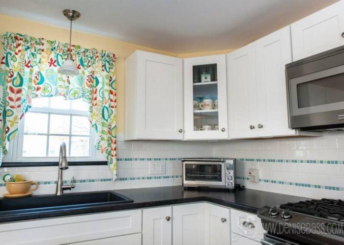 Waypoint cabinetry in white artic subway tile and glass mosaic backsplash rhodeislandkitchen also