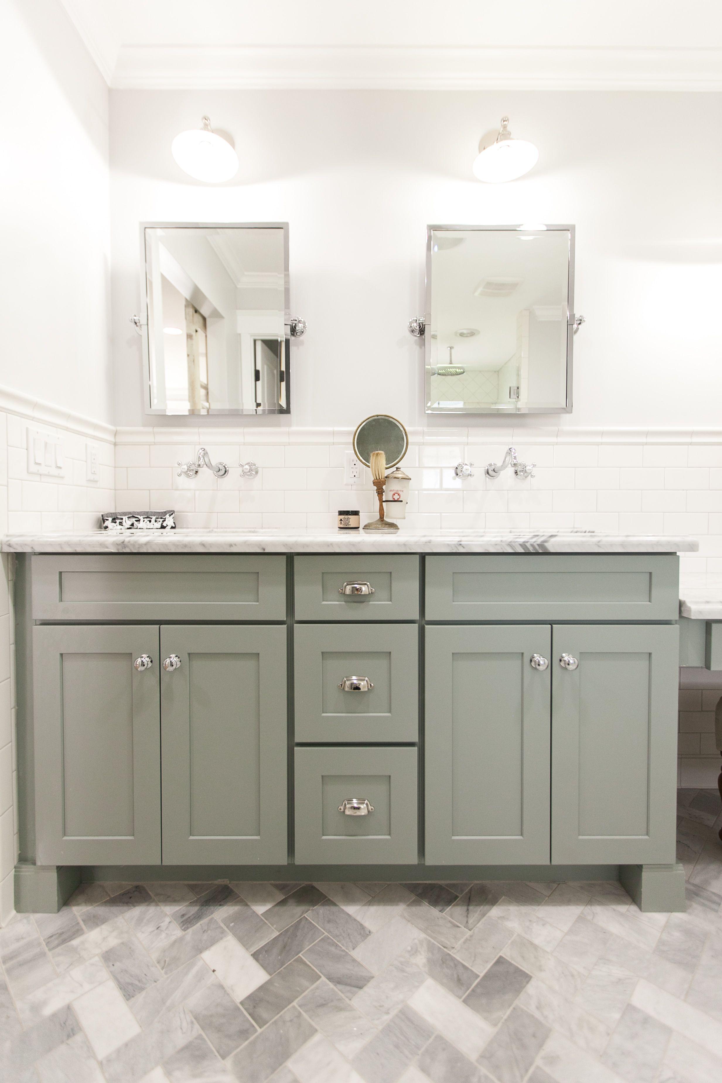 Grey shaker style bath vanity with carrara marble counter