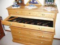 gun cabinet disguised as a dresser