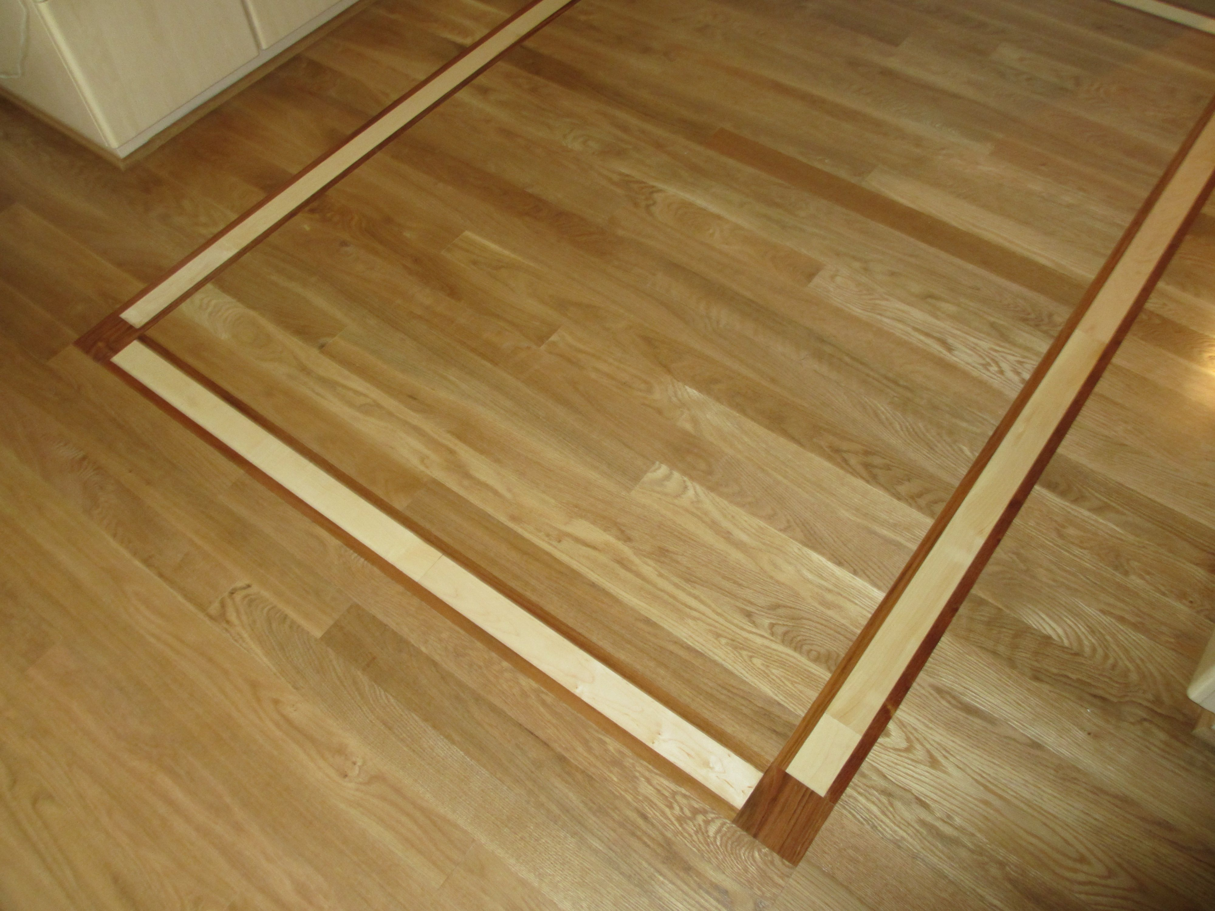 White oak flooring with Brazilian Cherry and Maple inlay