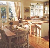 Country style kitchen with cream units. Garden trading ...