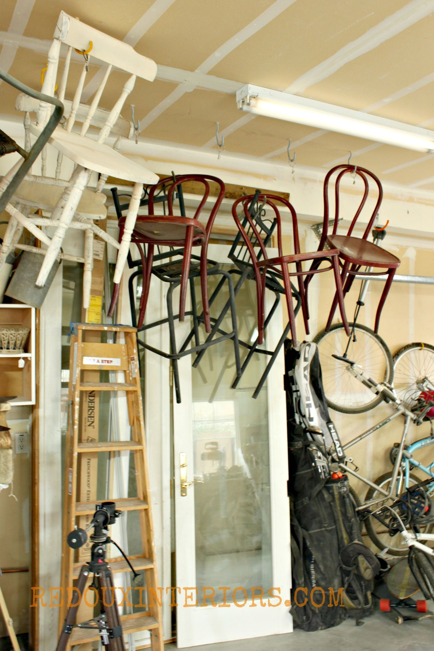 chairs hanging from ceiling faux fur chair throw hang the garage to save on storage
