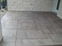 stamped concrete patio floor--hmmm not a bad idea ...