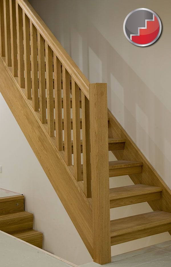 Oak staircase with open risers compliant with uk building