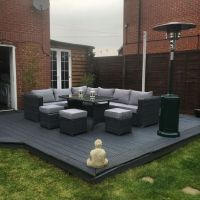 9 seater rattan garden furniture.. Grey decking.. Garden ...