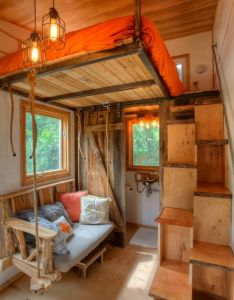 Austin tiny house interior in love with that couch swing this is purrfect  could see the cats now running up and down those alternating stairs also rh nz pinterest