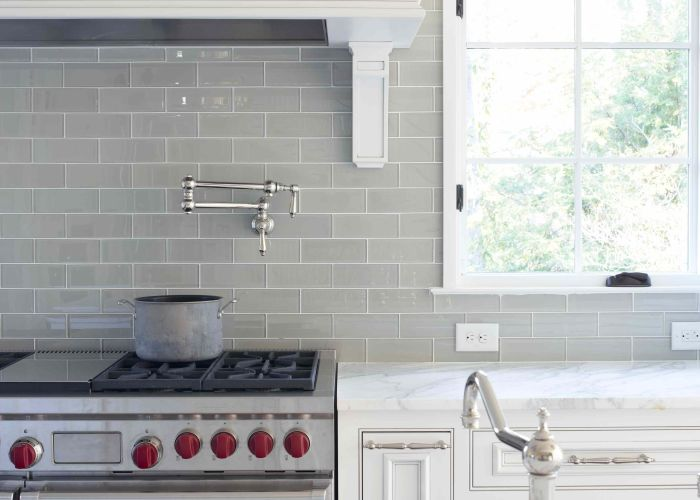 Smoke glass subway tile also love gray backsplash white cabinets and carrera marble