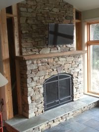 fireplace surround using natural veneer stone with a cut ...