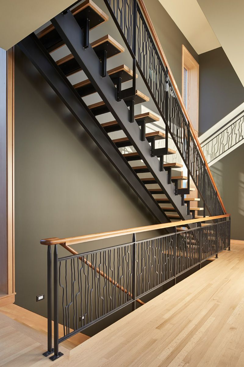 These striking steel and wood stairs have water jet